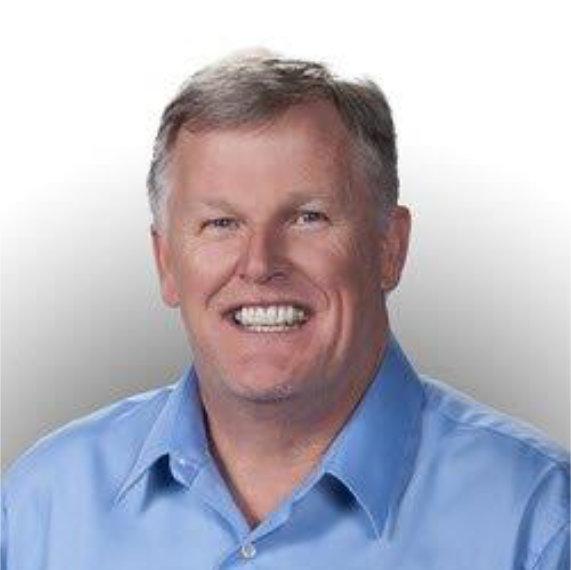 Smiling man wearing a blue shirt